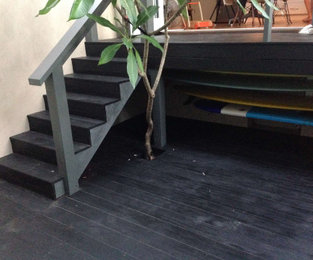 Ranbwick courtyard done with treated pine deck and stairs.  Stained black japan and ready for glass balustrade Randwick, NSW
